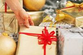 Closeup On Young Woman Taking Christmas Present Box Under Christmas Tree