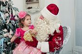 foto of saint-nicolas  - Girl in an elegant dress and Saint Nicolas - JPG
