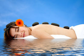 stock photo of stone-therapy  - A beautiful woman relaxing at a spa - JPG