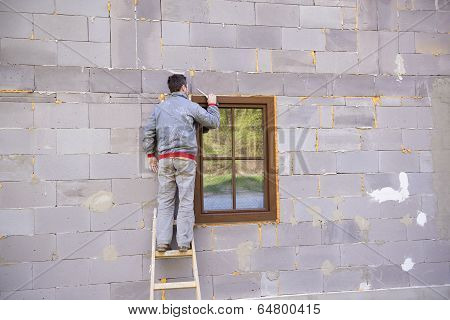 Man insulating windows
