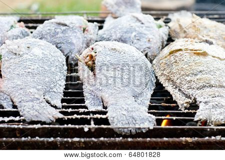 Roasted tilapia fish on grill