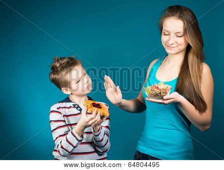 Diet. Dieting concept. Healthy Food. Beautiful Young Woman choosing between cereals and pastry. Weig