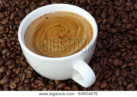 cup of coffee on a coffee beans backgroun