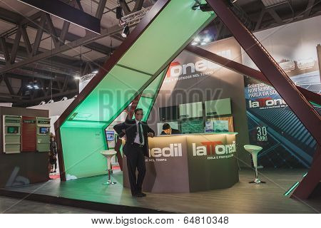 Exhibitors In Their Stand At Solarexpo 2014 In Milan, Italy