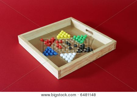 Chinese checkers on red background