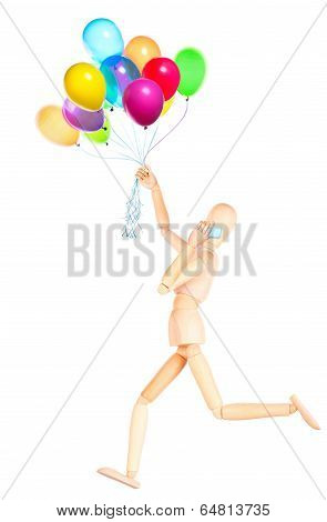 wooden Dummy with balloons talking on mobile phone