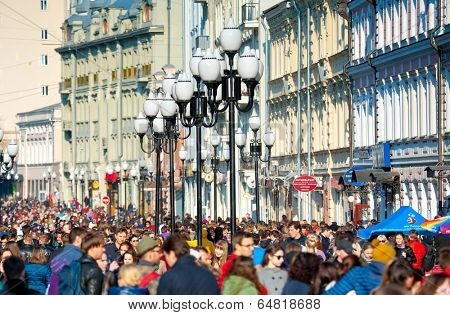 MOSCOW - April 13: Many people walking on the famous Arbat street on April 13, 2014 in Moscow. This street is one of the few pedestrian streets in Moscow, which is usually visited by tourists.