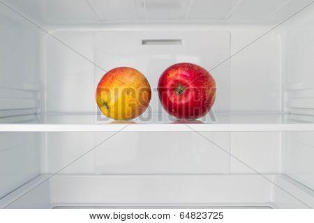 Apples in open empty refrigerator  Weight loss diet concept