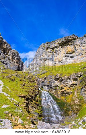Cascada Cola de Caballo waterfall under Monte Perdido at Ordesa Valley Aragon Huesca Pyrenees of Spain