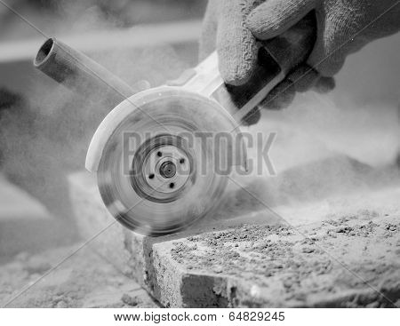Grinder Worker Cuts A Stone