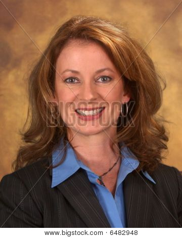 Businesswoman In Suit And Blue Blouse