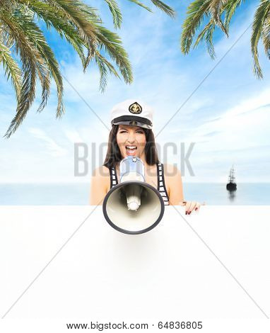 Young, beautiful and sexy sailor girl with a megaphone over sea and sky background
