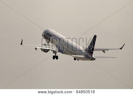 Departing LOT Polish Airlines Embraer ERJ-195LR aircraft