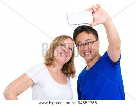 Two smiling friends taking selfie
