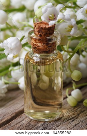 Essence In A Glass Bottle Of Lily Of The Valley Flowers