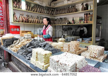 SHANGHAI, CHINA - APRIL 11, 2014: Small candy store in Qibao water village in Shanghai