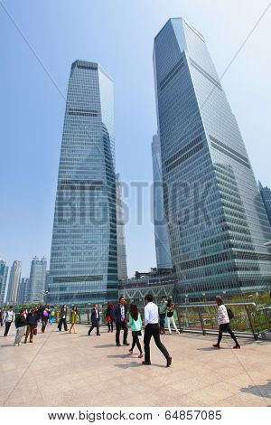 SHANGHAI, CHINA - APRIL 14, 2014: People on Shanghai Lujiazui flyover and buildings of Pudong New Area