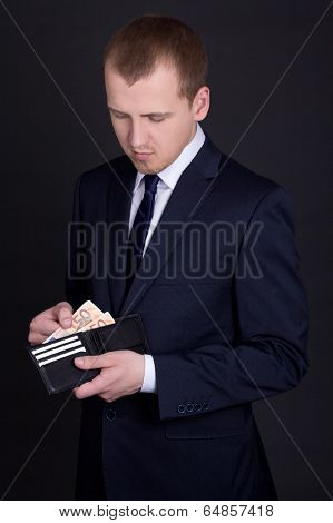 Young Business Man Holding Leather Purse With Euro Banknotes