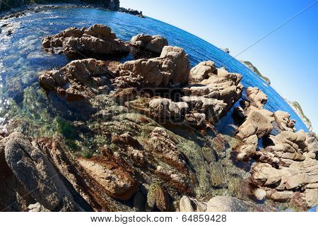 Beautiful evening landscape of rocky sea coast. Fish-eye lens.