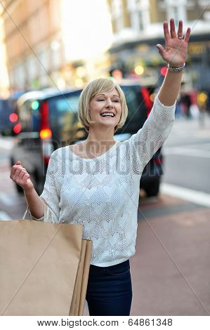 Casual Woman Hailing A Taxi Cab