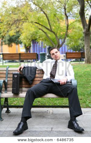 Bored Business Man On Bench