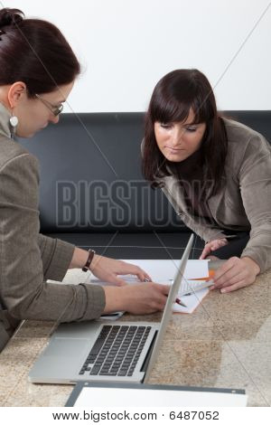 Two Business Women At The Meeting