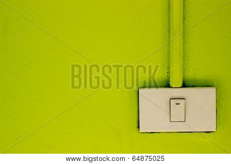 Light Switches On The Green Wall