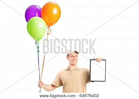 Delivery boy holding balloons and a clipboard isolated on white background