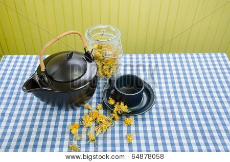 Dried Coltsfoot Herbal On Table And Clay Tea Set