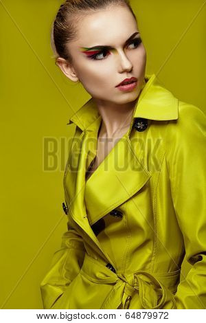 Fashion Shot Of Woman In Lime Coat