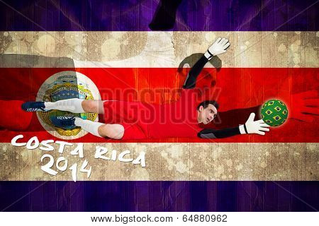 Goalkeeper in red making a save against costa rica flag in grunge effect