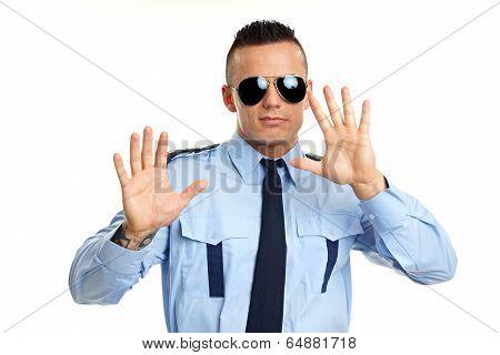 Policeman shows hand
