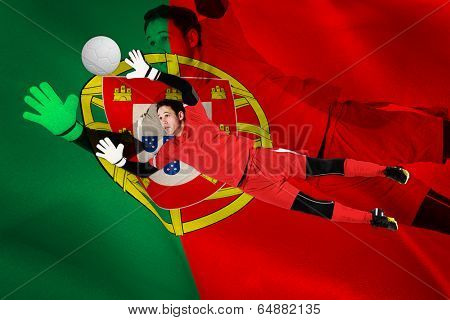 Fit goal keeper jumping up against digitally generated portugese national flag