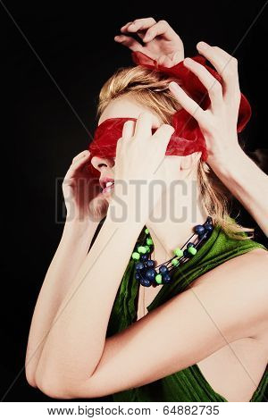 Portrait Of A Beautiful Young Woman With Red Blindfold