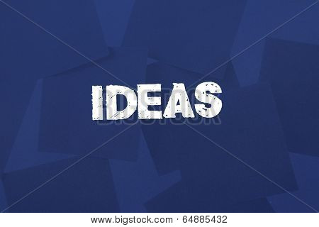 The word ideas against digitally generated blue paper strewn