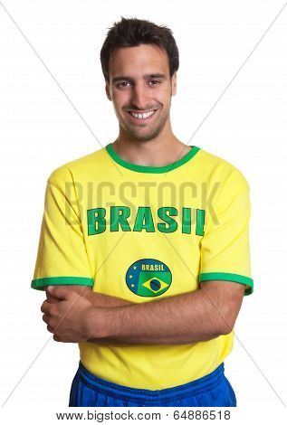 Attractive Guy With Brazilian Jersey Standing With Crossed Arms