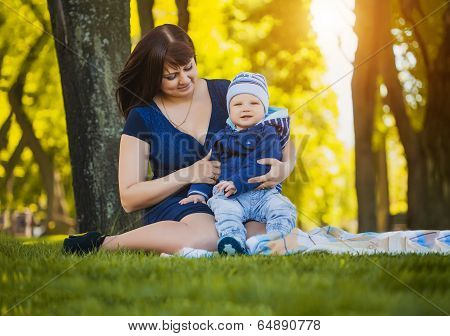 Happy mother and baby in the summer park