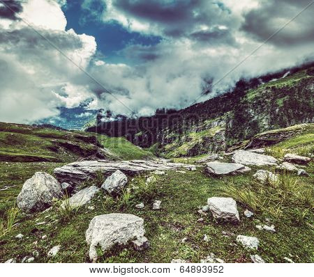 Vintage retro effect filtered hipster style travel image of mountain landscape in Himalayas. Kullu valley, Himachal Pradesh, India