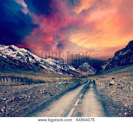 Vintage retro effect filtered hipster style travel image of road in mountains