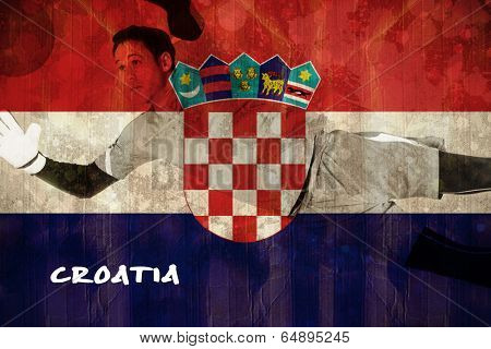 Fit goal keeper jumping up against croatia flag in grunge effect