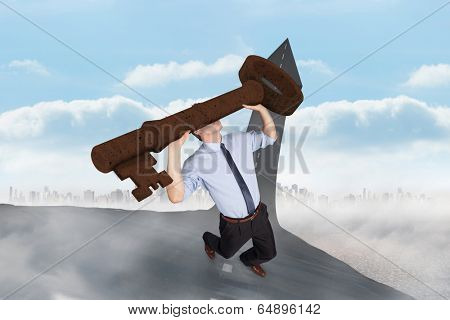 Businessman carrying large key with arms raised against road turning into arrow