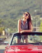 pic of muscle-car  - Beautiful young woman in a convertible car enjoying a summer day - JPG