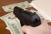 image of glock  - Robbery with the use of a gun. ** Note: Shallow depth of field - JPG