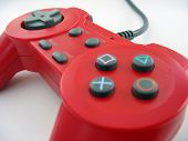 stock photo of video game controller  - a red video game controller isolated over white - JPG