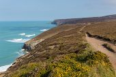 South West Coast Path near Porthtowan and St Agnes Cornwall England UK a popular tourist destination poster