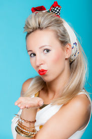 stock photo of flirty  - Portrait beautiful young blonde woman in pin - JPG