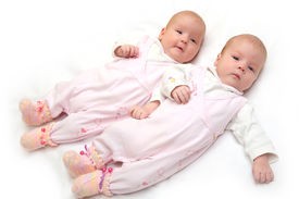 picture of twin baby  - Portrait of two twin sisters age two months - JPG