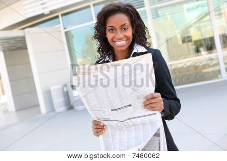 Pretty Business Woman Reading Newspaper