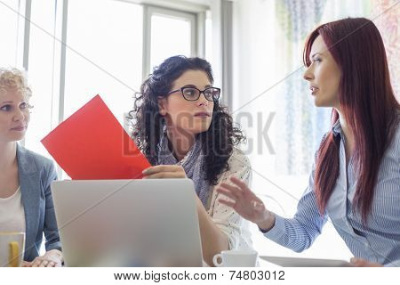 Creative businesswomen discussing in meeting at office