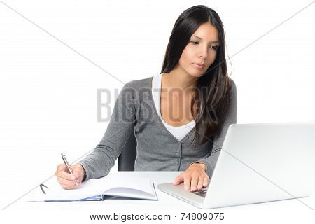 Friendly Young Woman Working At A Desk